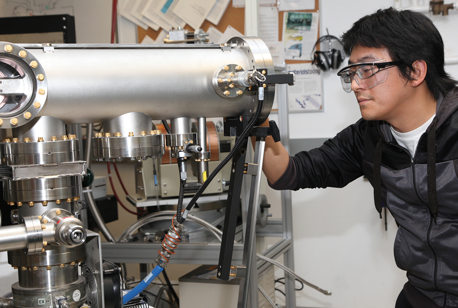 Nanoscale Engineering student looks at tool in a lab on SUNY Poly's Albany campus