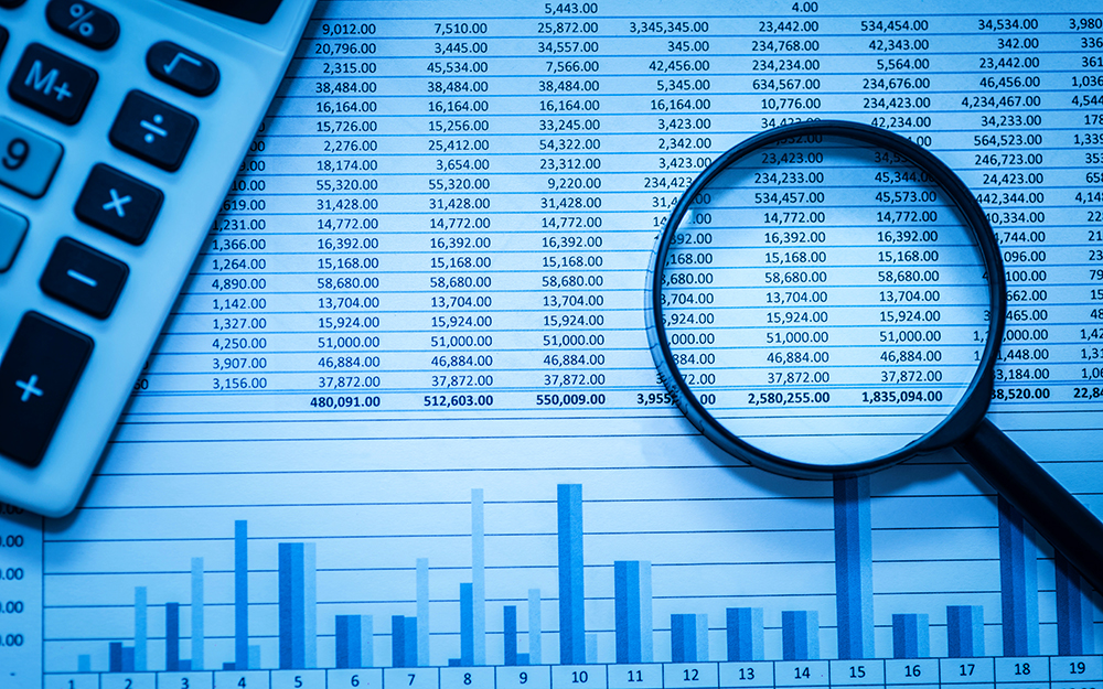 New concentration in Forensic Accounting and Valuation - magnifying glass and spreadsheet