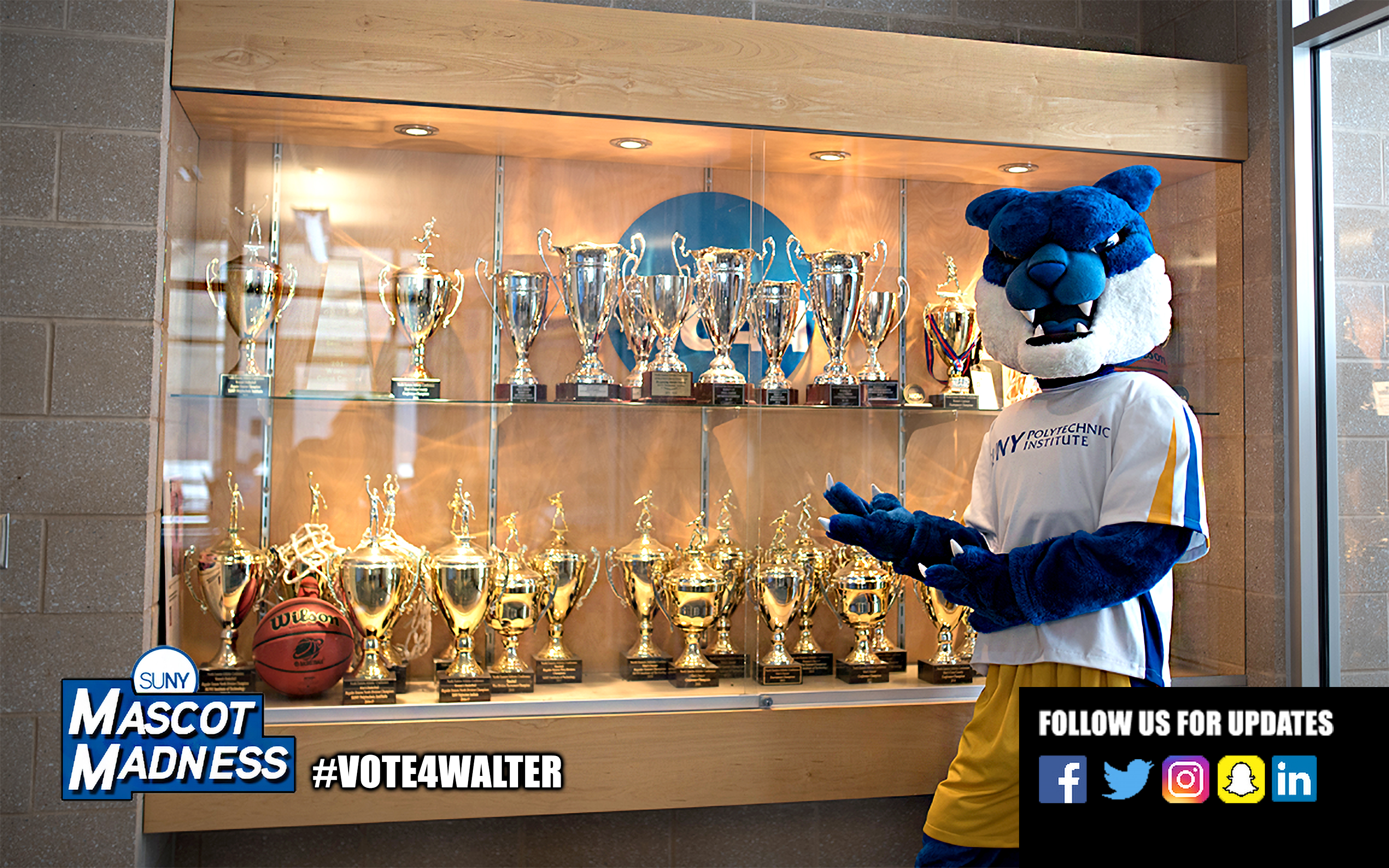 Walter in front of the SUNY Poly trophy case