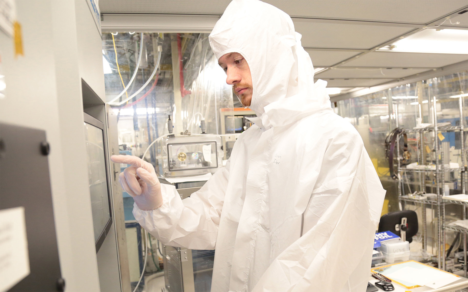 SUNY Poly student in a cleanroom on the Albany Campus