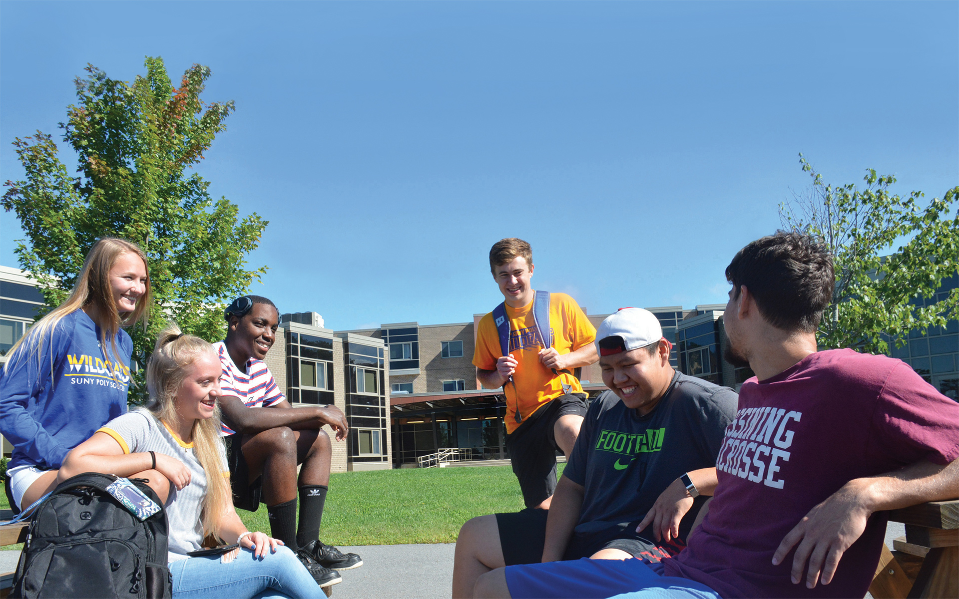Students sit outside Oriskany Hall