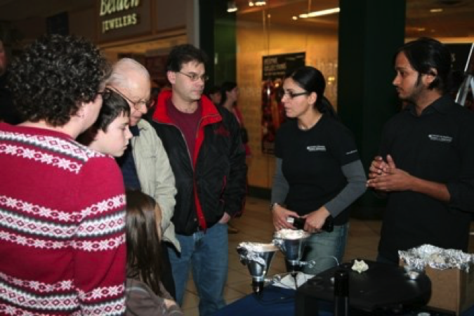 Visitors at the nano in the mall booth