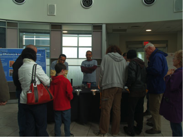 Visitors look at information at CNSE Community Day