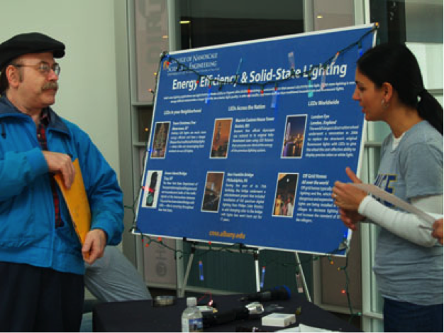 Prof. Shahedipour-Sandvik speaks to a visitor at CNSE Community Day