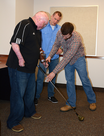 Students assist veteran with adaptive golf club they created