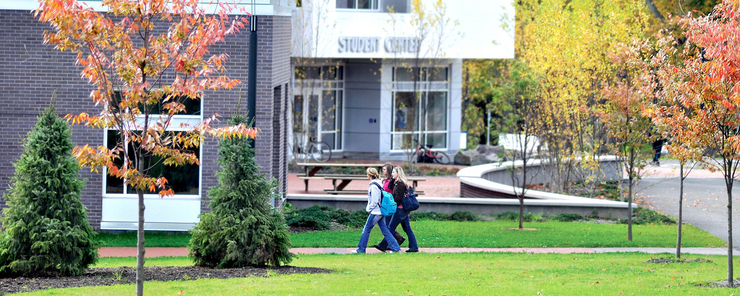 Students walk into Student Center on Utica campus