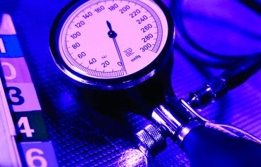 MS Family Nurse Practitioner - illustrative photo of blood pressure cuff and folder