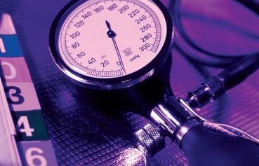 BS/MS Family Nurse Practitioner - illustrative photo of patient chart and blood pressure cuff