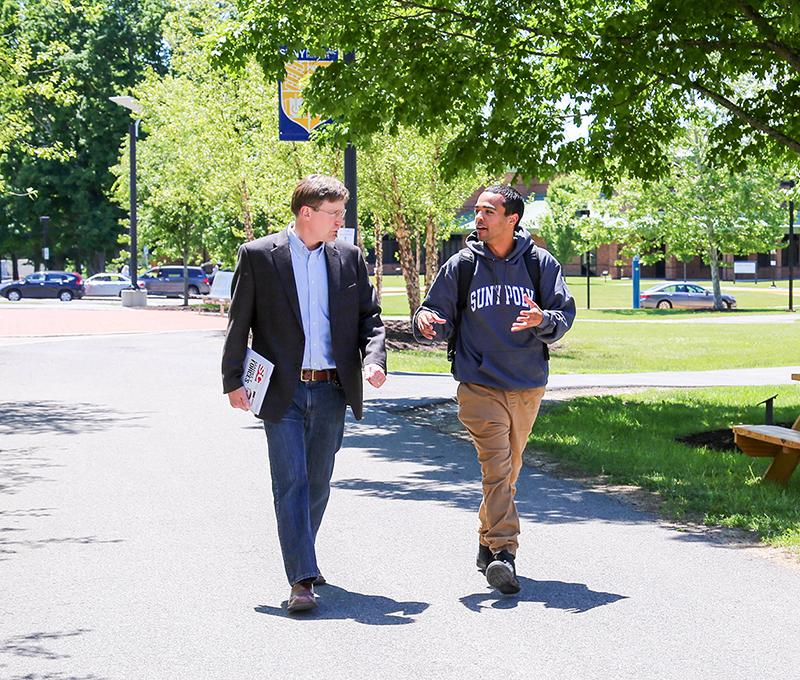 SUNY Poly professor and student walking on campus